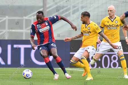 Crotone's forward Simy (L) and Udinese's midfielder Roberto Pereyra in action during the Italian Serie A soccer match between FC Crotone and Udinese Calcio at Ezio Scida stadium in Crotone, Italy, 17 april 2021.