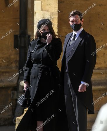 Princess Beatrice and Jack Brooksbank, stand at the Galilee Porch of St George's Chapel, Windsor Castle, Windsor, England, during the funeral of Britain's Prince Philip. Prince Philip died April 9 at the age of 99 after 73 years of marriage to Britain's Queen Elizabeth II