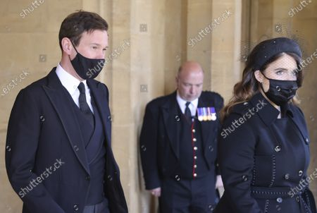 Princess Eugenie, right, and her husband Jack Brooksbank, left, attend the funeral of Britain's Prince Philip inside Windsor Castle in Windsor, England, . Prince Philip died April 9 at the age of 99 after 73 years of marriage to Britain's Queen Elizabeth II