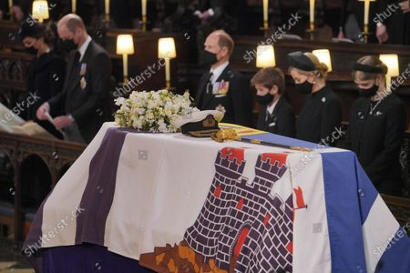 Mourners including, front row from left, Kate, Duchess of Cambridge, Prince William, Prince Edward, Viscount Severn, Lady Louise Mountbatten-Windsor, and Sophie, Countess of Wessex, during the funeral of Prince Philip, at St George's Chapel in Windsor Castle, Windsor, England, . Prince Philip died April 9 at the age of 99 after 73 years of marriage to Britain's Queen Elizabeth II