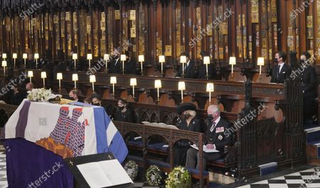 Mourners including, front row from left, Kate Duchess of Cambridge, Prince William, Prince Edward, Viscount Severn, Lady Louise Mountbatten-Windsor, the Countess of Wessex, the Duchess of Cornwall during the funeral of Prince Philip, at St George's Chapel in Windsor Castle, Windsor, England, . Prince Philip died April 9 at the age of 99 after 73 years of marriage to Britain's Queen Elizabeth II. Back row, from left, the Earl of Snowdon, Peter Phillips, Mike Tindall, Zara Tindall, Jack Brooksbank, Princess Eugenie, Edoardo Mapelli Mozzi and Princess Beatrice