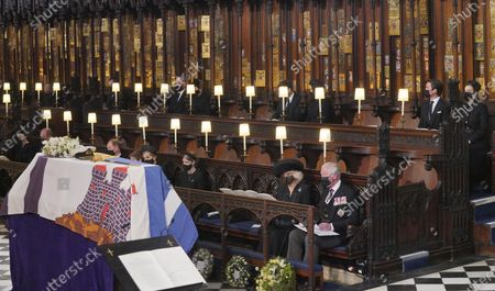 Mourners including, front row from left, Kate Duchess of Cambridge, Prince William, Prince Edward, Viscount Severn, Lady Louise Mountbatten-Windsor, the Countess of Wessex, the Duchess of Cornwall and Prince Charles during the funeral of Prince Philip, at St George's Chapel in Windsor Castle, Windsor, England, . Prince Philip died April 9 at the age of 99 after 73 years of marriage to Britain's Queen Elizabeth II. Back row, from left, the Earl of Snowdon, Peter Phillips, Mike Tindall, Zara Tindall, Jack Brooksbank, Princess Eugenie, Edoardo Mapelli Mozzi and Princess Beatrice
