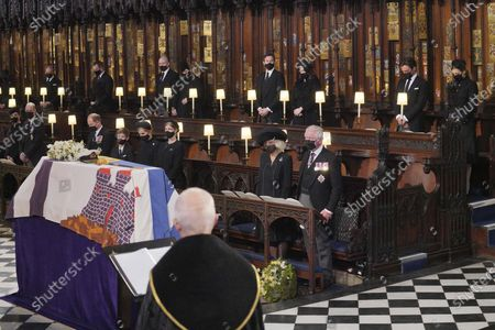 Mourners including, front row from left, Kate Duchess of Cambridge, Prince William, Prince Edward, Viscount Severn, Lady Louise Mountbatten-Windsor, Sophie Countess of Wessex, Camilla Duchess of Cornwall and Prince Charles during the funeral of Prince Philip, at St George's Chapel in Windsor Castle, Windsor, England, . Prince Philip died April 9 at the age of 99 after 73 years of marriage to Britain's Queen Elizabeth II. Back row, from left, the Earl of Snowdon, Peter Phillips, Mike Tindall, Zara Tindall, Jack Brooksbank, Princess Eugenie, Edoardo Mapelli Mozzi and Princess Beatrice