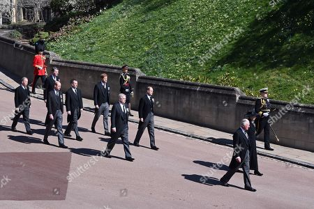 Princess Anne, Princess Royal, Prince Charles, Prince Charles, Prince Andrew, Duke of York, Prince Edward, Prince Edward, Prince William, Prince William, Peter Phillips, Prince Harry, Duke of Sussex, Earl of Snowdon David Armstrong-Jones and Vice-Admiral Sir Tim Laurence follow Prince Philip, Duke of Edinburgh's coffin during the Ceremonial Procession during the funeral of Prince Philip, Duke of Edinburgh at Windsor Castle on April 17, 2021 in Windsor, England. Prince Philip of Greece and Denmark was born 10 June 1921, in Greece. He served in the British Royal Navy and fought in WWII. He married the then Princess Elizabeth on 20 November 1947 and was created Duke of Edinburgh, Earl of Merioneth, and Baron Greenwich by King VI. He served as Prince Consort to Queen Elizabeth II until his death on April 9 2021, months short of his 100th birthday. His funeral takes place today at Windsor Castle with only 30 guests invited due to Coronavirus pandemic restrictions.