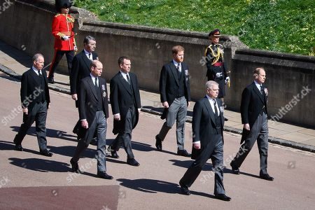 Earl of Snowdon David Armstrong-Jones, Vice-Admiral Sir Tim Laurence, Prince William, Prince William, Peter Phillips, Prince Harry, Duke of Sussex, Prince Andrew, Duke of York and Prince Edward, Prince Edward during the funeral of Prince Philip, Duke of Edinburgh at Windsor Castle on April 17, 2021 in Windsor, England. Prince Philip of Greece and Denmark was born 10 June 1921, in Greece. He served in the British Royal Navy and fought in WWII. He married the then Princess Elizabeth on 20 November 1947 and was created Duke of Edinburgh, Earl of Merioneth, and Baron Greenwich by King VI. He served as Prince Consort to Queen Elizabeth II until his death on April 9 2021, months short of his 100th birthday. His funeral takes place today at Windsor Castle with only 30 guests invited due to Coronavirus pandemic restrictions.