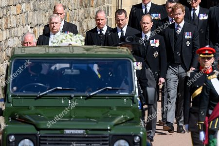 Peter Phillips, Princess Anne, Princess Royal, Prince Edward, Prince Edward, Prince Harry, Duke of Sussex and Vice-Admiral Sir Tim Laurence walk behind the purpose built Land Rover Hearse during the funeral of Prince Philip, Prince Philip at Windsor Castle on April 17, 2021 in Windsor, England. Prince Philip of Greece and Denmark was born 10 June 1921, in Greece. He served in the British Royal Navy and fought in WWII. He married the then Princess Elizabeth on 20 November 1947 and was created Prince Philip, Earl of Merioneth, and Baron Greenwich by King VI. He served as Prince Consort to Queen Elizabeth II until his death on April 9 2021, months short of his 100th birthday. His funeral takes place today at Windsor Castle with only 30 guests invited due to Coronavirus pandemic restrictions.