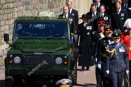 Peter Phillips, Princess Anne, Princess Royal, Prince Edward, Prince Edward, Prince Harry, Duke of Sussex and Vice-Admiral Sir Tim Laurence walk behind the purpose built Land Rover Hearseduring the funeral of Prince Philip, Prince Philip at Windsor Castle on April 17, 2021 in Windsor, England. Prince Philip of Greece and Denmark was born 10 June 1921, in Greece. He served in the British Royal Navy and fought in WWII. He married the then Princess Elizabeth on 20 November 1947 and was created Prince Philip, Earl of Merioneth, and Baron Greenwich by King VI. He served as Prince Consort to Queen Elizabeth II until his death on April 9 2021, months short of his 100th birthday. His funeral takes place today at Windsor Castle with only 30 guests invited due to Coronavirus pandemic restrictions.