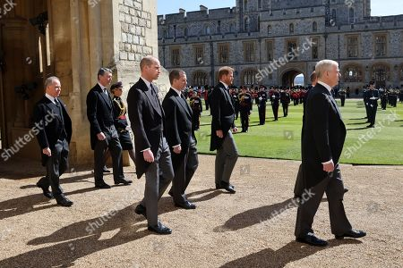 Earl of Snowdon David Armstrong-Jones, Vice-Admiral Sir Tim Laurence, Prince William, Prince William, Peter Phillips, Prince Harry, Duke of Sussex and Prince Andrew, Duke of York follow Prince Philip, Duke of Edinburgh's coffin during the Ceremonial Procession during the funeral of Prince Philip, Prince Philip at Windsor Castle on April 17, 2021 in Windsor, England. Prince Philip of Greece and Denmark was born 10 June 1921, in Greece. He served in the British Royal Navy and fought in WWII. He married the then Princess Elizabeth on 20 November 1947 and was created Prince Philip, Earl of Merioneth, and Baron Greenwich by King VI. He served as Prince Consort to Queen Elizabeth II until his death on April 9 2021, months short of his 100th birthday. His funeral takes place today at Windsor Castle with only 30 guests invited due to Coronavirus pandemic restrictions.