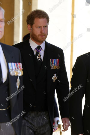 Stock Photo of Prince Harry, Duke of Sussex during the funeral of Prince Philip, Prince Philip at Windsor Castle on April 17, 2021 in Windsor, England. Prince Philip of Greece and Denmark was born 10 June 1921, in Greece. He served in the British Royal Navy and fought in WWII. He married the then Princess Elizabeth on 20 November 1947 and was created Prince Philip, Earl of Merioneth, and Baron Greenwich by King VI. He served as Prince Consort to Queen Elizabeth II until his death on April 9 2021, months short of his 100th birthday. His funeral takes place today at Windsor Castle with only 30 guests invited due to Coronavirus pandemic restrictions.
