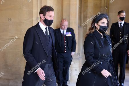Stock Image of Jack Brooksbank and Princess Eugenie arrive for the funeral of Prince Philip, Prince Philip at Windsor Castle on April 17, 2021 in Windsor, England. Prince Philip of Greece and Denmark was born 10 June 1921, in Greece. He served in the British Royal Navy and fought in WWII. He married the then Princess Elizabeth on 20 November 1947 and was created Prince Philip, Earl of Merioneth, and Baron Greenwich by King VI. He served as Prince Consort to Queen Elizabeth II until his death on April 9 2021, months short of his 100th birthday. His funeral takes place today at Windsor Castle with only 30 guests invited due to Coronavirus pandemic restrictions.