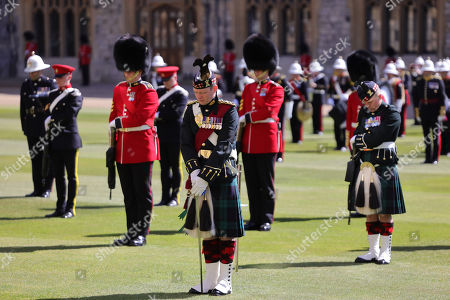The Highlanders, 4th Battalion, The Royal Regiment of Scotland and Grenadier Guards bow their heads in respect during the funeral of Prince Philip, Prince Philip at Windsor Castle on April 17, 2021 in Windsor, England. Prince Philip of Greece and Denmark was born 10 June 1921, in Greece. He served in the British Royal Navy and fought in WWII. He married the then Princess Elizabeth on 20 November 1947 and was created Prince Philip, Earl of Merioneth, and Baron Greenwich by King VI. He served as Prince Consort to Queen Elizabeth II until his death on April 9 2021, months short of his 100th birthday. His funeral takes place today at Windsor Castle with only 30 guests invited due to Coronavirus pandemic restrictions.