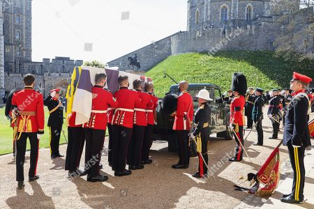 The bearer Party found by The Queen's Company, 1st Battalion Grenadier Guards carry the coffin of HRH Prince Philip, Prince Philip to the purpose built Land Rover Hearse during the funeral of Prince Philip, Prince Philip at Windsor Castle on April 17, 2021 in Windsor, England. Prince Philip of Greece and Denmark was born 10 June 1921, in Greece. He served in the British Royal Navy and fought in WWII. He married the then Princess Elizabeth on 20 November 1947 and was created Prince Philip, Earl of Merioneth, and Baron Greenwich by King VI. He served as Prince Consort to Queen Elizabeth II until his death on April 9 2021, months short of his 100th birthday. His funeral takes place today at Windsor Castle with only 30 guests invited due to Coronavirus pandemic restrictions.