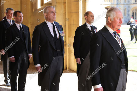Vice-Admiral Sir Tim Laurence, Peter Phillips, Prince Andrew, Duke of York, Prince Edward, Prince Edward and Prince Charles, Prince Charles follow Prince Philip, Duke of Edinburgh's coffin during the Ceremonial Procession during the funeral of Prince Philip, Prince Philip at Windsor Castle on April 17, 2021 in Windsor, England. Prince Philip of Greece and Denmark was born 10 June 1921, in Greece. He served in the British Royal Navy and fought in WWII. He married the then Princess Elizabeth on 20 November 1947 and was created Prince Philip, Earl of Merioneth, and Baron Greenwich by King VI. He served as Prince Consort to Queen Elizabeth II until his death on April 9 2021, months short of his 100th birthday. His funeral takes place today at Windsor Castle with only 30 guests invited due to Coronavirus pandemic restrictions.