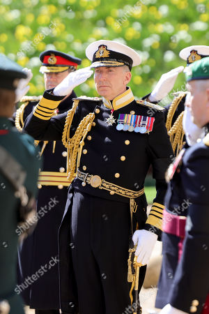 First Sea Lord and Chief of Naval Staff Admiral Tony Radakin salutes during the funeral of Prince Philip, Prince Philip at Windsor Castle on April 17, 2021 in Windsor, England. Prince Philip of Greece and Denmark was born 10 June 1921, in Greece. He served in the British Royal Navy and fought in WWII. He married the then Princess Elizabeth on 20 November 1947 and was created Prince Philip, Earl of Merioneth, and Baron Greenwich by King VI. He served as Prince Consort to Queen Elizabeth II until his death on April 9 2021, months short of his 100th birthday. His funeral takes place today at Windsor Castle with only 30 guests invited due to Coronavirus pandemic restrictions.