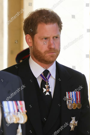 Prince Harry, Duke of Sussex during the funeral of Prince Philip, Prince Philip at Windsor Castle on April 17, 2021 in Windsor, England. Prince Philip of Greece and Denmark was born 10 June 1921, in Greece. He served in the British Royal Navy and fought in WWII. He married the then Princess Elizabeth on 20 November 1947 and was created Prince Philip, Earl of Merioneth, and Baron Greenwich by King VI. He served as Prince Consort to Queen Elizabeth II until his death on April 9 2021, months short of his 100th birthday. His funeral takes place today at Windsor Castle with only 30 guests invited due to Coronavirus pandemic restrictions.