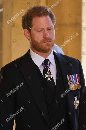 Prince Harry, Duke of Sussex during the Ceremonial Procession during the funeral of Prince Philip, Prince Philip at Windsor Castle on April 17, 2021 in Windsor, England. Prince Philip of Greece and Denmark was born 10 June 1921, in Greece. He served in the British Royal Navy and fought in WWII. He married the then Princess Elizabeth on 20 November 1947 and was created Prince Philip, Earl of Merioneth, and Baron Greenwich by King VI. He served as Prince Consort to Queen Elizabeth II until his death on April 9 2021, months short of his 100th birthday. His funeral takes place today at Windsor Castle with only 30 guests invited due to Coronavirus pandemic restrictions.