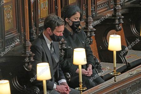 Stock Photo of Jack Brooksbank and Princess Eugenie during the funeral of the Duke of Edinburgh in St George's Chapel, Windsor Castle, Berkshire