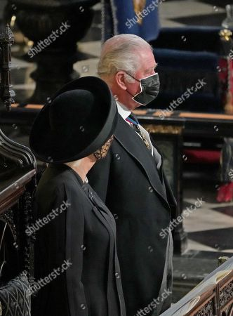 Prince Charles and Camilla Duchess of Cornwall during the funeral of the Duke of Edinburgh in St George's Chapel, Windsor Castle, Berkshire