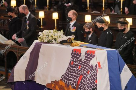 Mourners, including, front row, from left, Catherine Duchess of Cambridge, Prince William, the Prince Edward, James Viscount Severn, Lady Louise Windsor Mountbatten-Windsor, and Sophie Countess of Wessex, during the funeral of the Duke of Edinburgh at St George's Chapel, Windsor Castle, Berkshire.