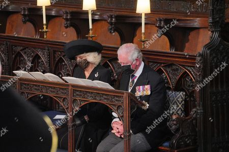 Camilla Duchess of Cornwall and Prince Charles during the Duke of Edinburgh's funeral at St George's Chapel, in Windsor Castle, Berkshire.