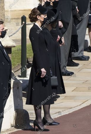 Stock Image of Catherine Duchess of Cambridge, Catherine Duchess of Cambridge and Camilla, Camilla Duchess of Cornwall at the funeral of Prince Philip, The Duke of Edinburgh, at Windsor Castle.