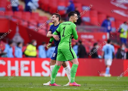 Chelsea's goalkeeper Kepa Arrizabalaga, right, celebrates with his teammate Cesar Azpilicueta after winning the English FA Cup semifinal soccer match between Chelsea and Manchester City at Wembley Stadium in London, England