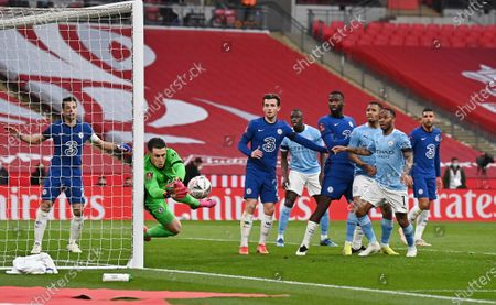 Chelsea's goalkeeper Kepa Arrizabalaga saves during the English FA Cup semifinal soccer match between Chelsea and Manchester City at Wembley Stadium in London, England