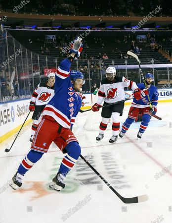 New York Rangers' Artemi Panarin reacts after scoring a goal against the New Jersey Devils during the second period of an NHL hockey game, in New York