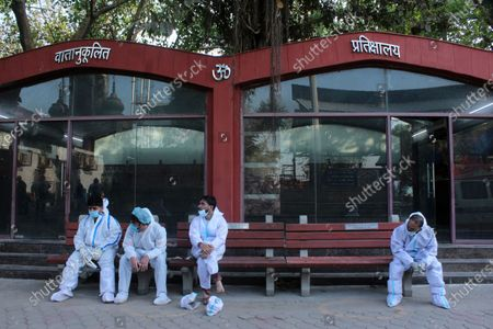Relatives wearing personal protective equipment (PPE) wait after the cremation of a victim, who died due to the coronavirus disease (COVID-19), at a crematorium in New Delhi, India on April 17, 2021. India on Saturday reported 2,34,692 new Covid-19 cases and 1,341 deaths in the last 24 hours. The global death toll from the coronavirus surged past 3 million people, according to a count by John Hopkins University.