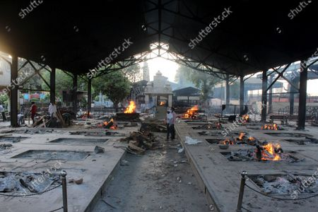 People who died due to the coronavirus disease (COVID-19), being cremated at a crematorium in New Delhi, India on April 17, 2021. India on Saturday reported 2,34,692 new Covid-19 cases and 1,341 deaths in the last 24 hours. The global death toll from the coronavirus surged past 3 million people, according to a count by John Hopkins University.