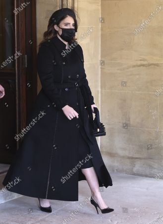 Princess Eugenie attends the funeral of Britain's Prince Philip inside Windsor Castle in Windsor, England, . Prince Philip died April 9 at the age of 99 after 73 years of marriage to Britain's Queen Elizabeth II