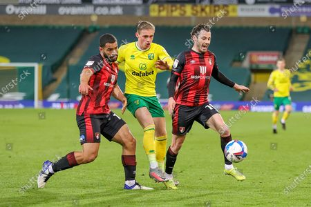 Przemyslaw Placheta (11) of Norwich City tussles with Adam Smith (15) of Bournemouth and Steve Cook (3) of Bournemouth during the EFL Sky Bet Championship match between Norwich City and Bournemouth at Carrow Road, Norwich