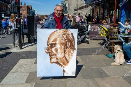 Artist Kaya Mar with his painting of HRH Prince Philip. Locals and visitors came into Windsor today to pay their respects to HRH Prince Philip on his funeral day, however, many heeded advice and stayed away due to the ongoing Covid-19 Pandemic. There was a heavy presence of armed police in the town together with numerous RBWM stewards. The funeral for the Duke of Edinburgh was a private event held at St George's Chapel in the grounds of Windsor Castle