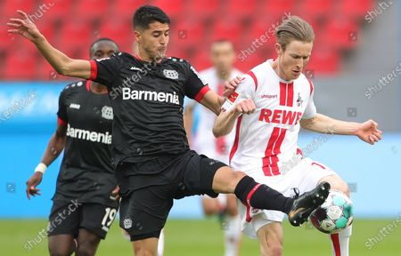 Stock Image of Leverkusen's Mitchell Weiser (L) in action against Cologne's Florian Kainz (R) during the German Bundesliga soccer match between Bayer 04 Leverkusen and FC Koeln in Leverkusen, Germany, 17 April 2021.