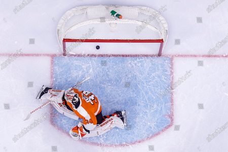 Philadelphia Flyers' Alex Lyon looks back as a shot by Washington Capitals' Alex Ovechkin goes past him for a goal during the first period of an NHL hockey game, in Philadelphia