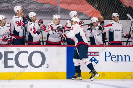 Washington Capitals' Alex Ovechkin, center, celebrates his goal with teammates during the first period of an NHL hockey game against the Philadelphia Flyers, in Philadelphia