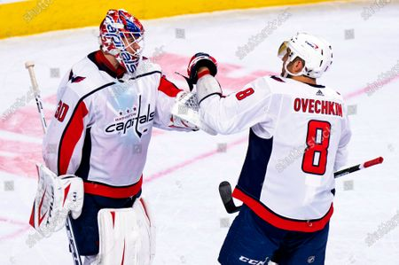 Washington Capitals' Ilya Samsonov, left, celebrates his goal with Alex Ovechkin, right, following the third period of an NHL hockey game against the Philadelphia Flyers, in Philadelphia. The Capitals won 6-3