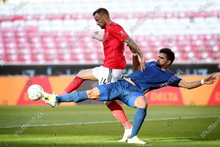 Haris Seferovic of SL Benfica (L) vies with Rodrigao of Gil Vicente FC during the Portuguese League football match between SL Benfica and Gil Vicente FC at the Luz stadium in Lisbon, Portugal on April 17, 2021.