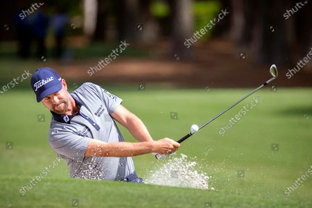Webb Simpson hits out of the bunker to the second green during the third round of the RBC Heritage golf tournament in Hilton Head Island, S.C