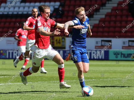 Stock Photo of L-R Charlton Athletic's Alex Gilbey and Teddy Bishop of Ipswich Town during Sky Bet League One between Charlton Athletic  and Ipswich Town at The Valley,  Woolwich, England on 17th April  2021.