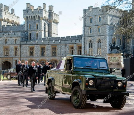 The landrover carrying the coffin of HRH The Duke of Ediburgh, follower by members of the Royal Family lead by Prince Charles as they arrive attend the funeral of HRH Prince Philip, The Duke of Edinburgh at St George's Chapel, Windsor Castle.