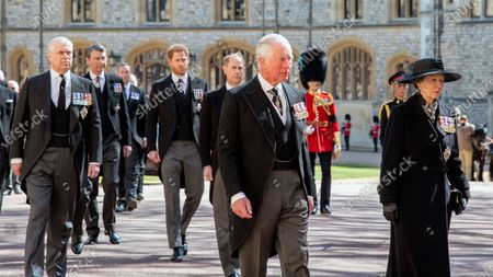 Prince Charles front centre leads the mourners attending the funeral of HRH Prince Philip, The Duke of Edinburgh. St George's Chapel, Windsor Castle. 17/04/2021. At his side Princess Anne Princess Anne, behind left Prince Andrew, Prince Harry and Prince William