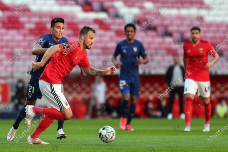 Benfica's Haris Seferovic (2L) in action with Gil Vicente's Vitor Carvalho (L) during the Portuguese First League soccer match Benfica vs Gil Vicente held at Luz Stadium, in Lisbon, Portugal, 17 April 2021.