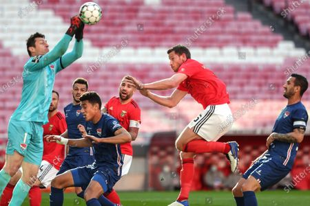 Benfica's Nicolas Otamendi (3R) and Jan Vertonghen (2R) in action with Gil Vicente's goalkeeper Denis (L) during the Portuguese First League soccer match Benfica vs Gil Vicente held at Luz Stadium, in Lisbon, Portugal, 17 April 2021.