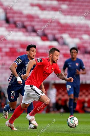 Benfica's Haris Seferovic (R) in action with Gil Vicente's Vitor Carvalho (L) during the Portuguese First League soccer match Benfica vs Gil Vicente held at Luz Stadium, in Lisbon, Portugal, 17 April 2021.
