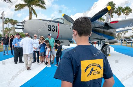 A group of Bay of Pig veterans and their families pose next to a B-26 bomber, used in the Bay of Pig invasion, during the 60th anniversary of the Bay of Pig Invasion's ceremony at the Monument of the Brigade 2506 Air Force at the Miami Executive Airport in Miami, Florida, USA, 17 April 2021. The Bay of Pigs Invasion in April 1961 was a failed attack launched by the CIA during the Kennedy administration to topple Cuban leader Fidel Castro. The Brigade 2506 was formed in 1960, by Cuban exiles, to attempt military incursion to Cuba.