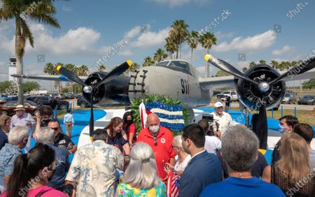 Bay of Pig Veterans and their families gather next to a B-26 bomber, used in the Bay of Pig invasion, during the 60th anniversary of the Bay of Pig Invasion's ceremony at the Monument of the Brigade 2506 Air Force at the Miami Executive Airport in Miami, Florida, USA, 17 April 2021. The Bay of Pigs Invasion in April 1961 was a failed attack launched by the CIA during the Kennedy administration to topple Cuban leader Fidel Castro. The Brigade 2506 was formed in 1960, by Cuban exiles, to attempt military incursion to Cuba.