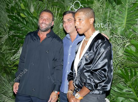 Stock Image of David Grutman, Mayor of Miami Francis X. Suarez and Pharrell Williams walk the red carpet to celebrate the opening of the Goodtime Hotel in Miami Beach, Florida, Friday, April 16, 2021.