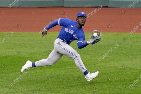 Toronto Blue Jays center fielder Jonathan Davis catches a fly ball for the out on Kansas City Royals' Whit Merrifield during the sixth inning in the first baseball game of a doubleheader, in Kansas City, Mo