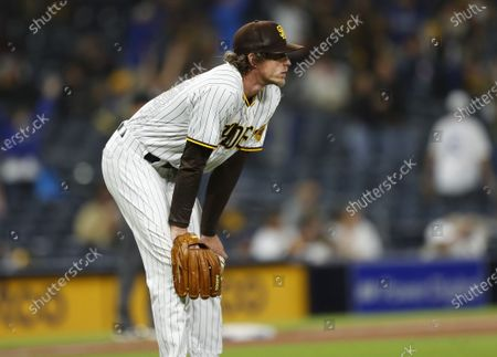 San Diego Padres pitcher Tim Hill watches a home run by Los Angeles Dodgers' Corey Seager in the 12th inning at Petco Park on Saturday, April 17, 2021 in San Diego, CA.